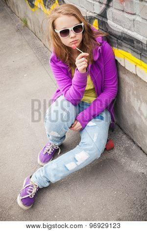 Blond Teenage Girl With Lollipop, Vertical Urban Portrait