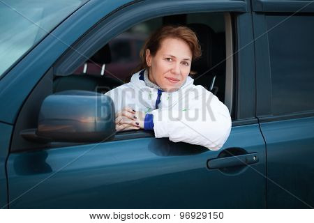 Young Caucasian Woman As A Driver In A Big Car