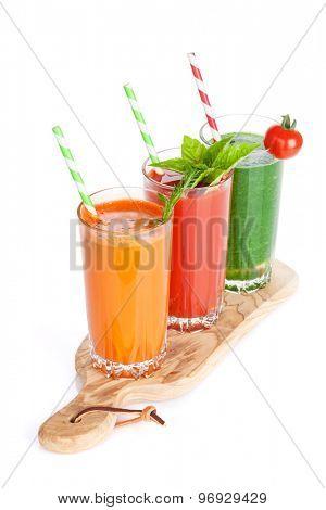 Fresh vegetable smoothie. Tomato, cucumber, carrot. Isolated on white background