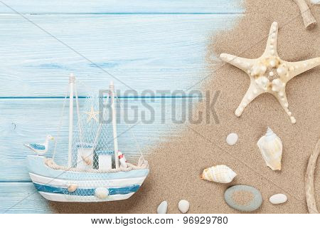 Travel and vacation background with items over sea sand. Top view with copy space