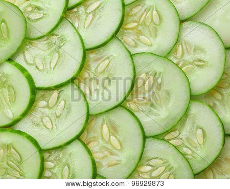 Fresh garden cucumber sliced texture background