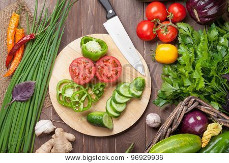 Fresh farmers garden vegetables cooking on wooden table. Top view