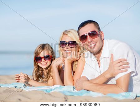 summer holidays, children and people concept - happy family on the beach