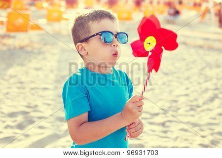 Little Boy Blowing Pinwheel