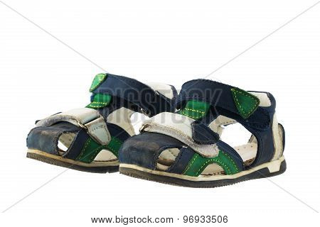 Dirty Kids Sandals Isolated On A White Background