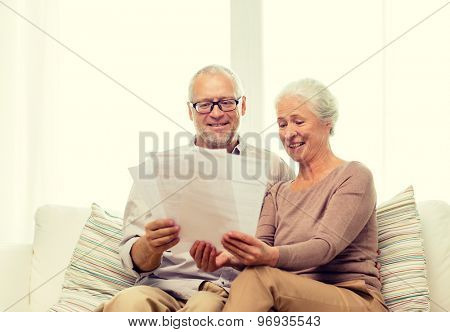 family, business, age and people concept - happy senior couple with papers at home