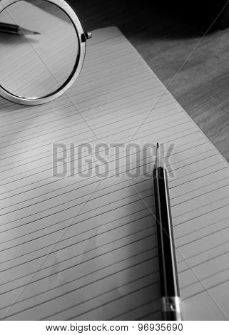 Pencil Lying On A Blank Paper