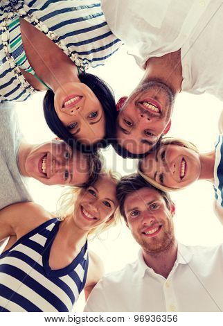 friendship, happiness and people concept - smiling friends in circle