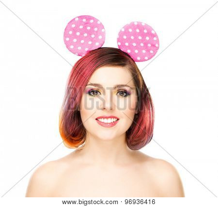 Beautiful young smiling woman in mickey mouse ears.