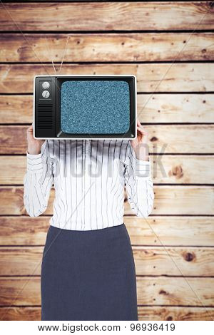 Businesswoman with box over head against wooden planks background