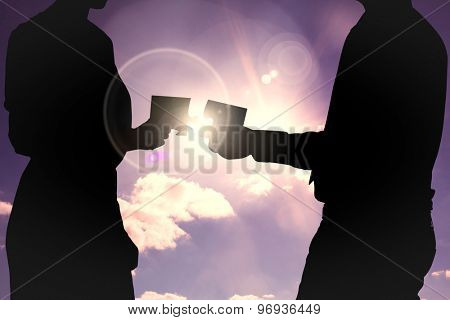 businesswoman against cloudy sky with sunshine
