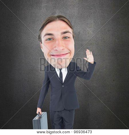 Geeky businessman waving against grey room