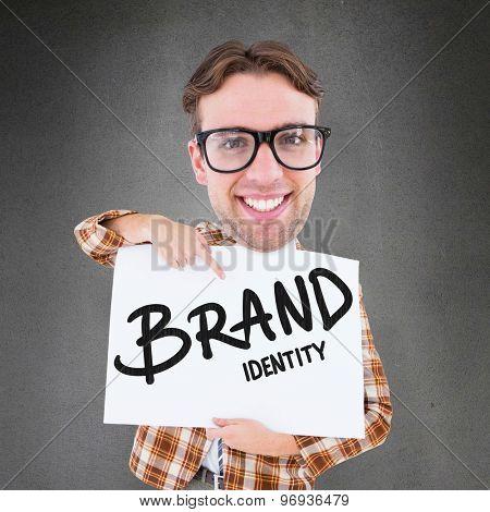 Geeky businessman showing card against grey room