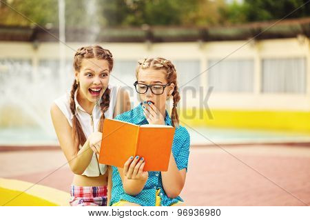 Best Friends Read Diary Together In Park.
