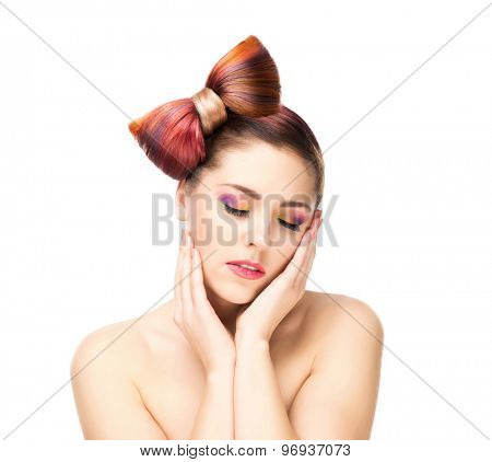 Beautiful sensitive woman with a bow hairstyle and colorful eye shadows on isolated background.