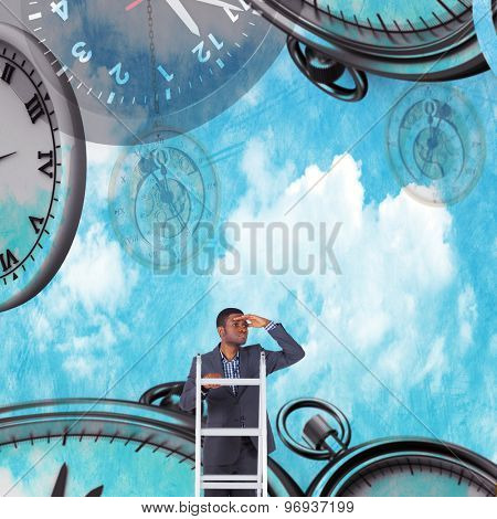 Businessman standing on ladder looking against painted blue sky