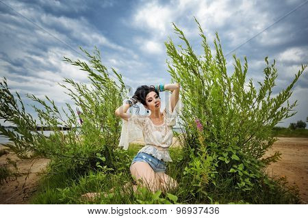 Boho Girl Sitting On Beach.