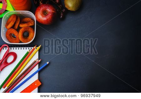 School Background With School Lunch, Pencils And A Notebook.