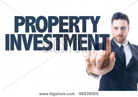 Business man pointing the text: Property Investment