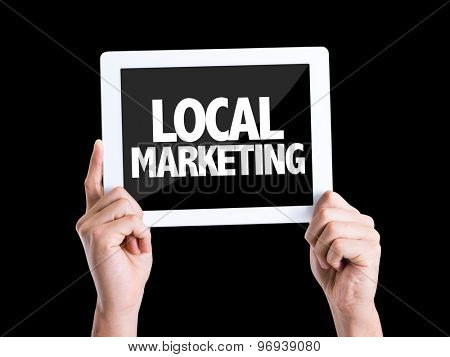 Tablet pc with text Local Marketing isolated on black background