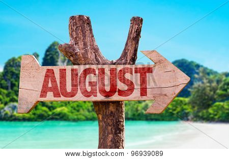 August wooden sign with beach background