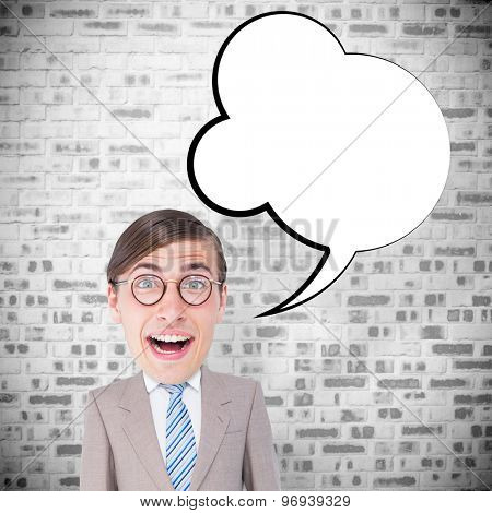 Geeky businessman against grey brick wall