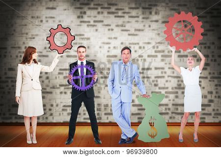Business people with icons graphics against room with brick wall