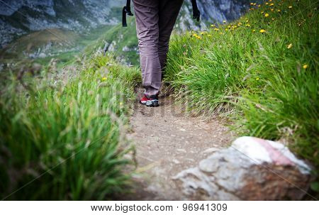 Woman trekking on mountain path