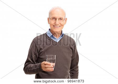 Studio shot of a senior man holding a glass of water and looking at the camera isolated on white background