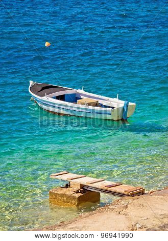 Old Wooden Fishermen Boat On Turquoise Beach
