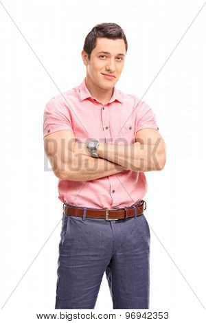 Vertical shot of a confident young man looking at the camera and smiling isolated on white background