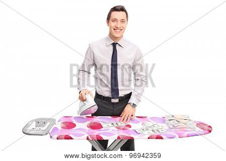 Studio shot of a young businessman ironing money on and ironing board isolated on white background