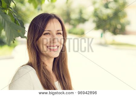 Young Smiling Woman With Healthy Teeth At Sunny Summer Day.