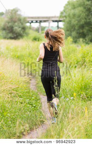 Jogging Woman At Summer Midday.