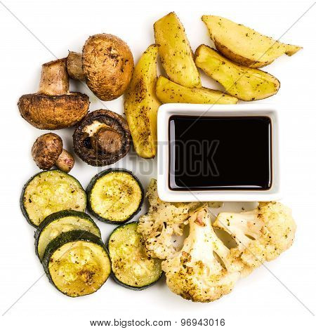 Roasted Vegetables With Sauce Isolated On White Background.