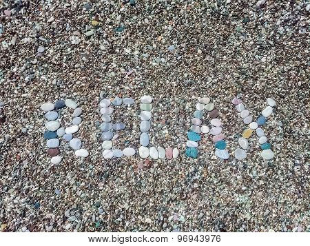 Relax Word From Stones On Pebble Beach