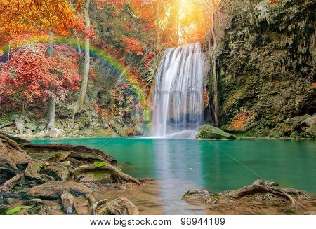 Wonderful Waterfall With Rainbows And Red Leaf In Deep Forest At Erawan Waterfall National Park.
