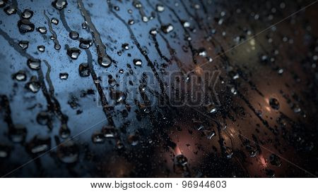 Rain Drops On Glass in Night