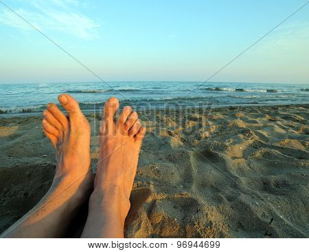 Two Bare Feet Of A Man By The Sea