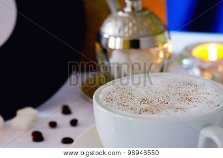 Coffee cup,coffee beans, vinyl plate and candle