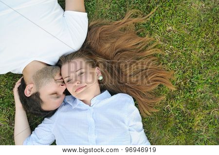 Young Couple In The Park In Summer Time