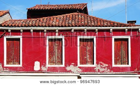Old Window House And Roof With Red Wall