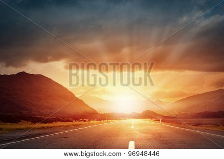 Sunrise above road