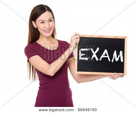 Asian woman with chalkboard showing a word exam