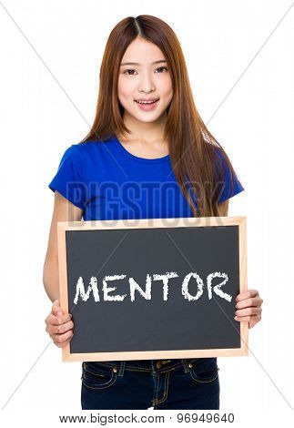 Young woman with black board showing a word of mentor