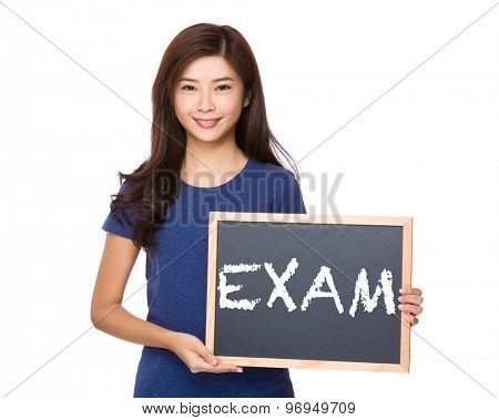 Asian woman with blackboard showing a word exam