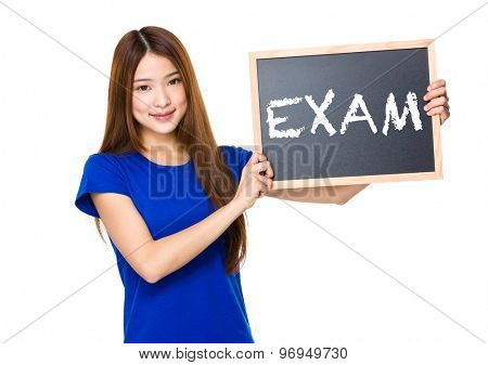 Beautiful asian women asian hold wood blackboard showing a word exam