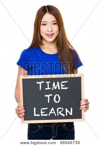 Young woman with black board showing phrase of time to learn