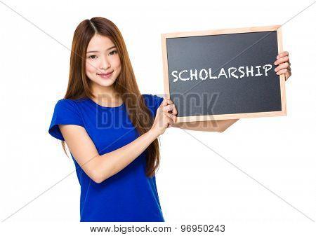 Beautiful asian women asian hold wood blackboard showing a word of scholarship
