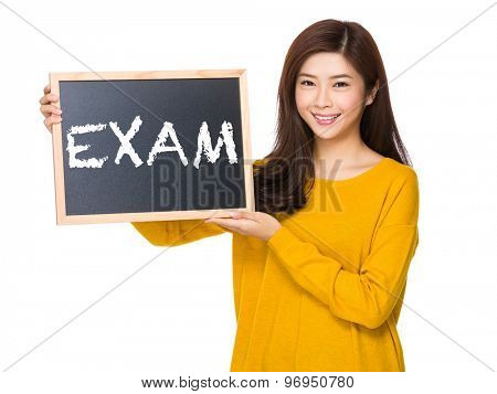 Young woman hand hold with the blackboard showing a word exam